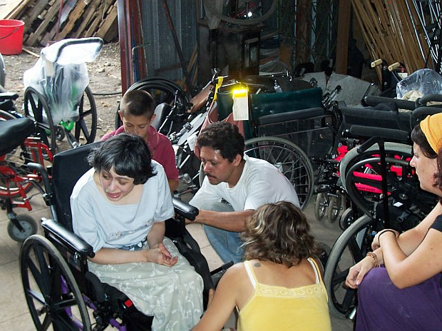 A trained staff of wheelchair repair persons, with the requisite skills and expertise to repair and refurbish wheelchairs.