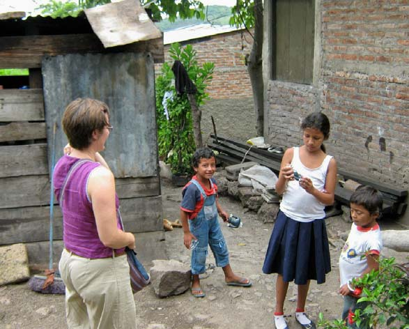 Marjory visits with kids in their homes in the barrios as part of the outreach efforts of Familias Especiales.