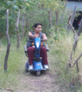 Maria Genara in her new wheelchair from Wisconsin/Nicaragua Wheelchair Project.